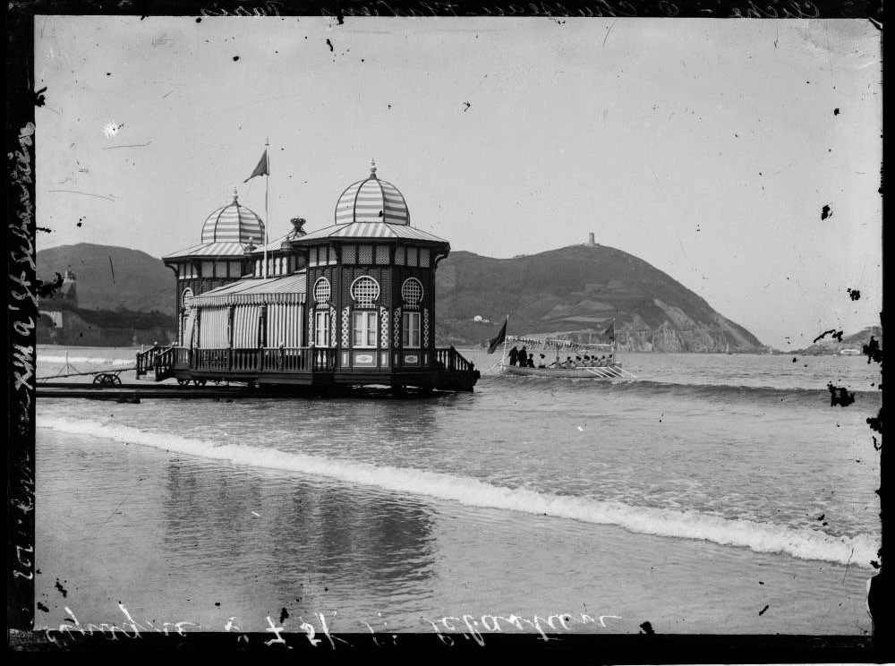 black and white image of victorian swimming hut in the water
