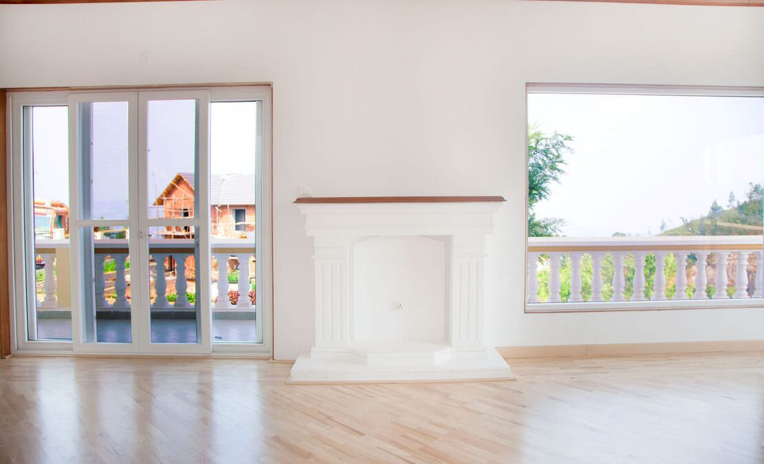 Fireplace of the living room with a walkout into the gallery