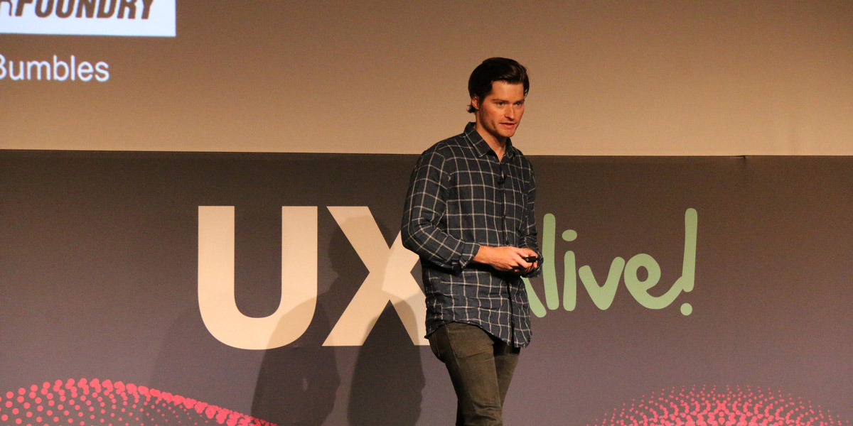 Jeff Humble, Head of Design at CareerFoundry, presenting on stage at UX Alive 2018