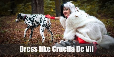 The iconic outfit of Cruella includes white, red, and black color scheme; her two tones hairstyle (black & white); and a lavish dress with a white fur coat, red gloves, and red high heels.