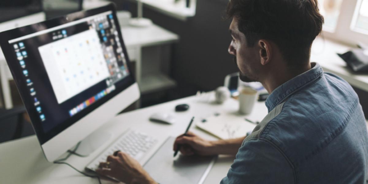 UI designer using UI animation software on a desktop