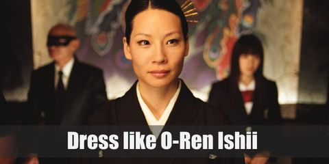 O-Ren Ishii simply wears the Japanese garment called 'Kimono' in white color and wooden flip-flops.