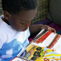 A boy reading a book