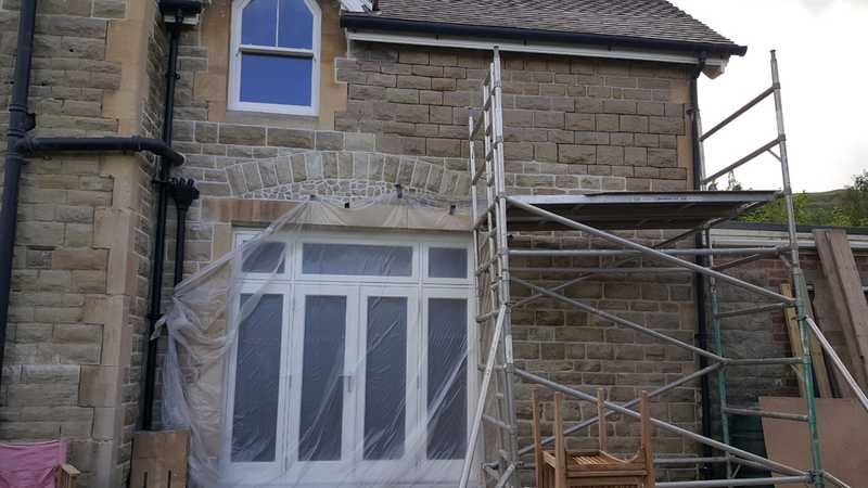 Rear view of a customers new french doors being put in, as well as repair work to the Malvern stone brickwork