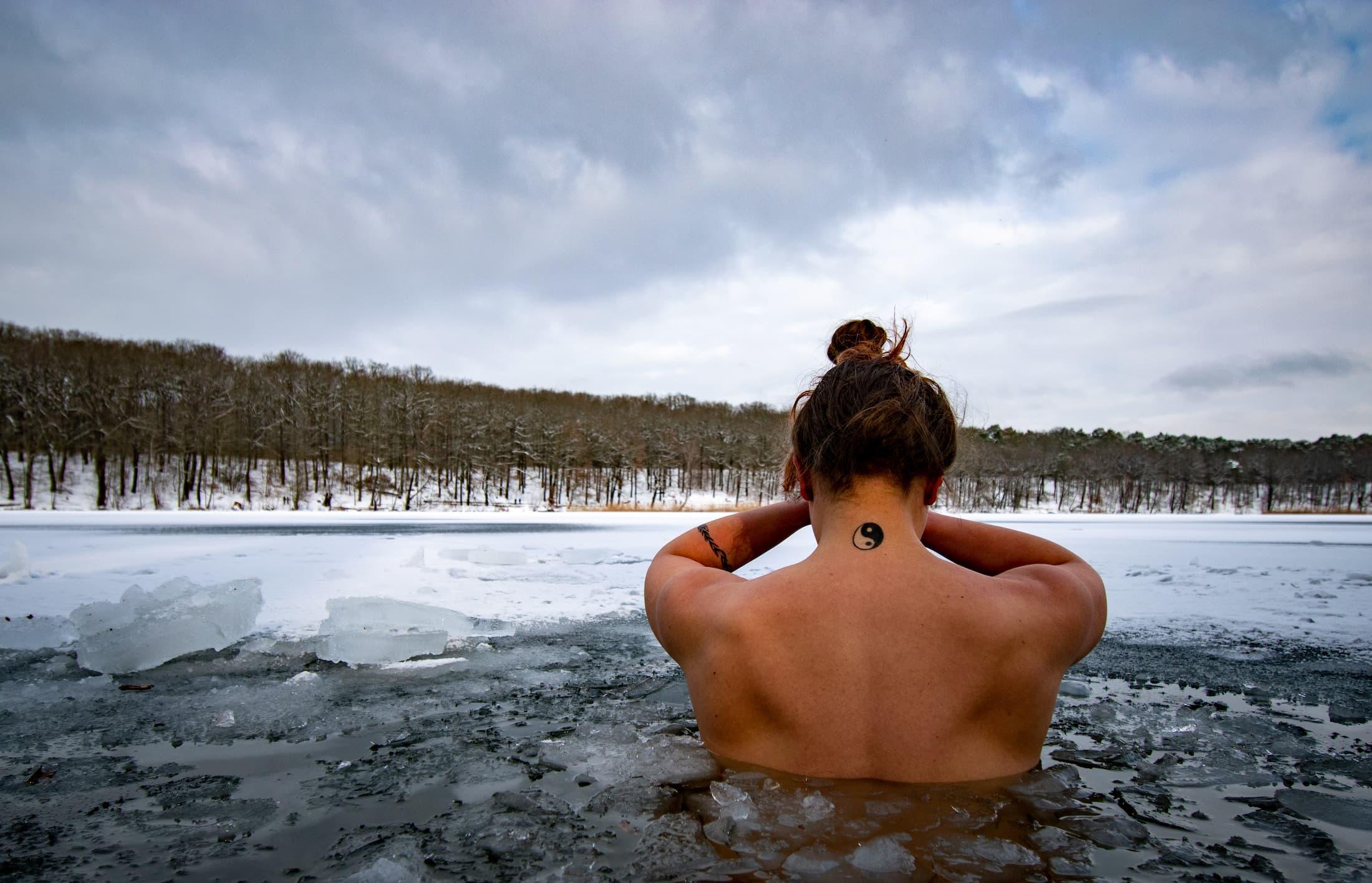 Yin Yang ice dip in lake