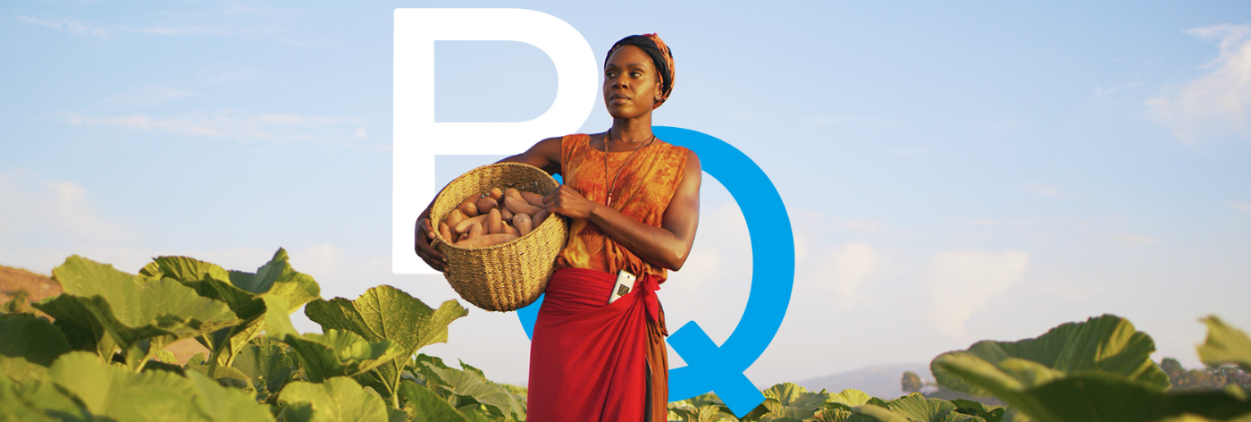 BanQu logo with a woman holding a basket of harvested goods.
