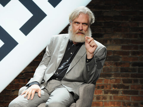 Image of George Church pointedly answering a question, beard in full.