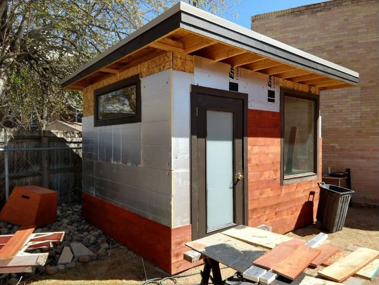 1 inch foam insulation and then stained-red cedar wood attached to the wood sheathing outside the backyard office, from Mr Money Mustache.