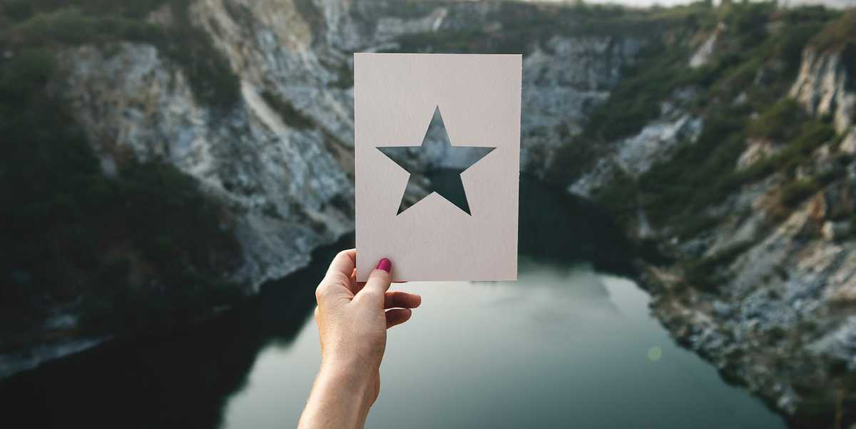 Person holding a card with star