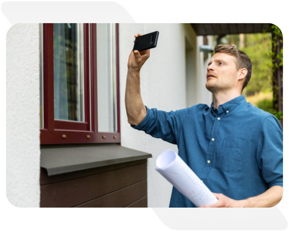Person taking a picture of a property