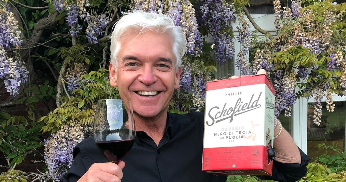 A photo of Phillip Schofield holding a box of Nero Di Troia Puglia