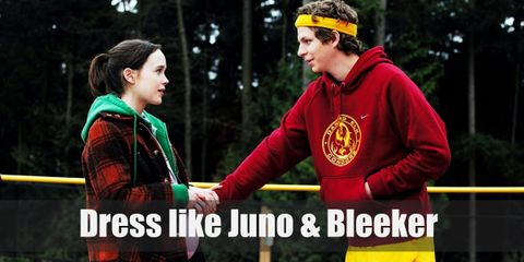 Juno wears an orange-striped shirt, a green min skirt, regular-fit denim pants, a green windbreaker, and rubber shoes. Bleeker wears his red track top, yellow shorts, knee-high white socks, and yellow armbands