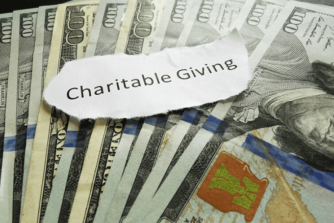 Charitable giving on top of money