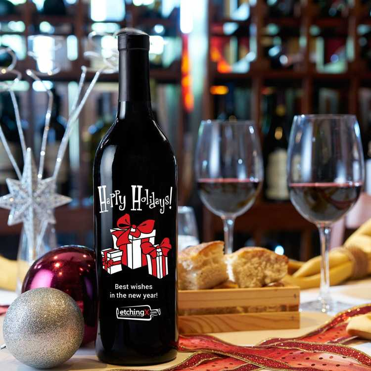 Happy Holidays custom etched design on a red wine bottle
