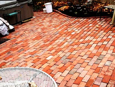A new brick patio installed in Cohasset, MA.