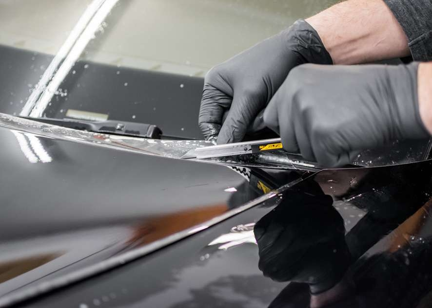 Paint protection film (PPF) being trimmed