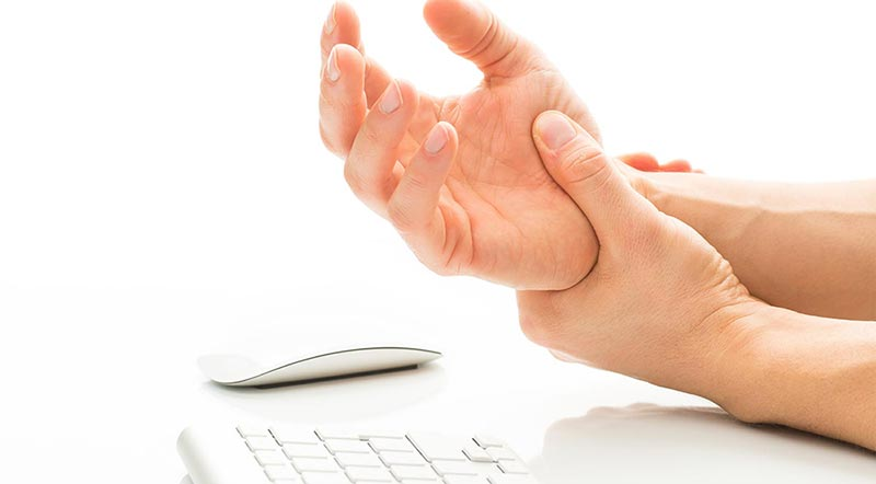 Holding wrist in pain.
