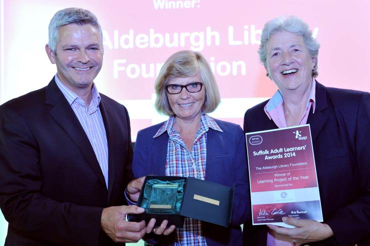 Simon Mead from the Eastern Enterprise Hub presents Anne Parsons (middle) and Lynne Walker (right) from the Aldeburgh Foundation with their award