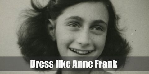 Anne Frank was wearing a dark sweater with a white peter pan collar. Other accessories were inspired to look similar to outfits worn during World War II.