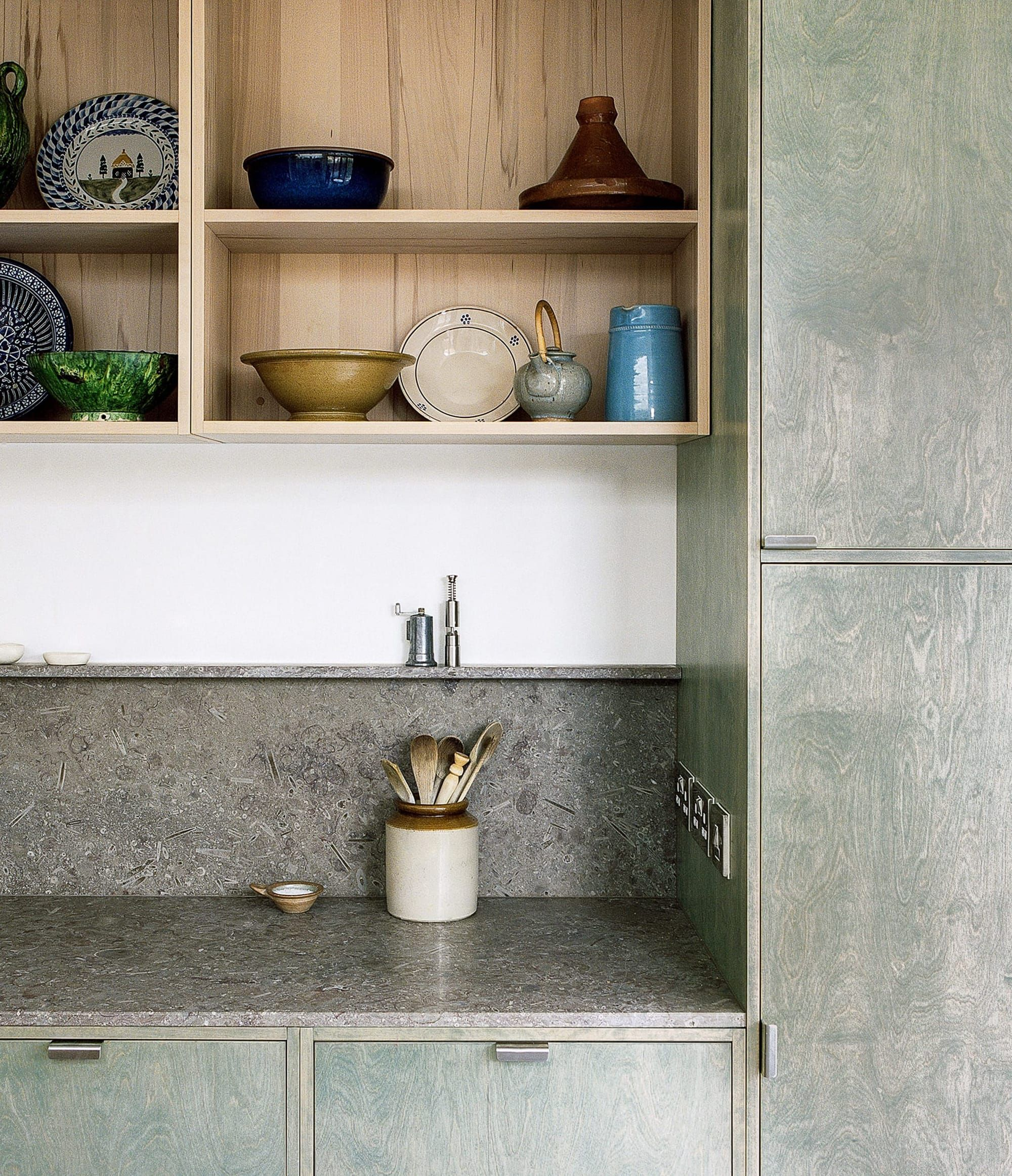 Steamed beech shelves, limestone worktop and moss green stained cabinetry.