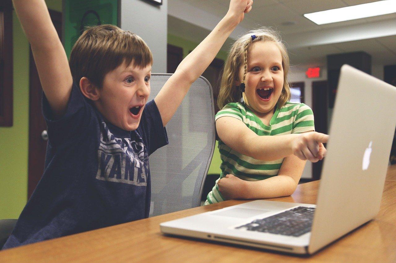 Children happy in front of computer