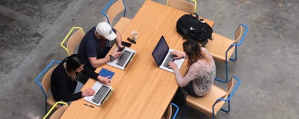 Facebook designers using laptops.