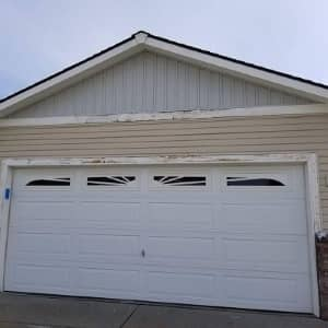 before shot of a weathered home with faded exterior paint