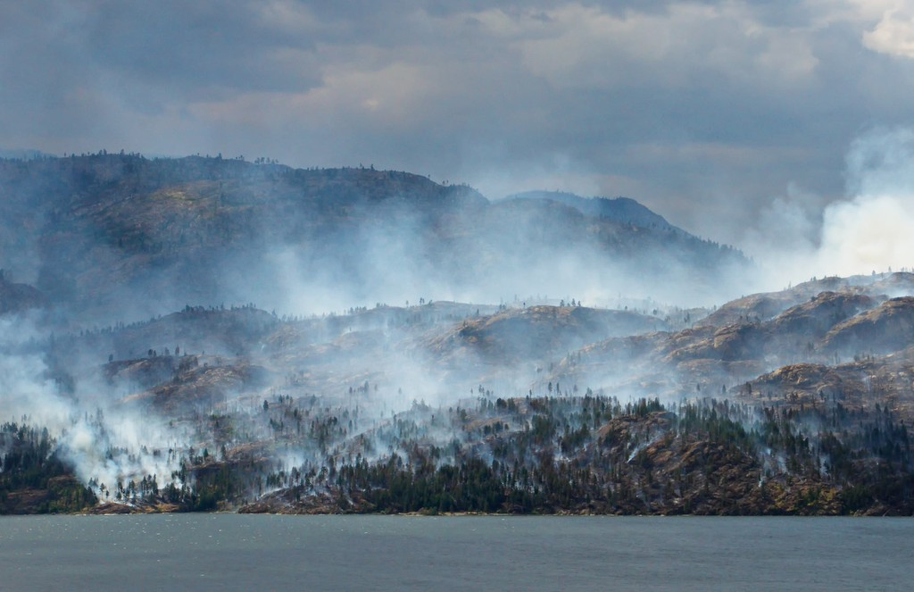 A forest fire on the hills overlooking Okanagan Lake in BC