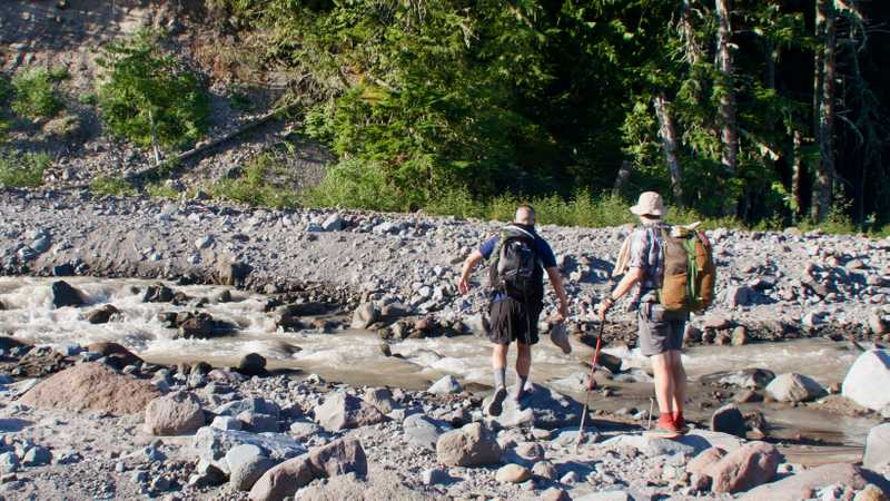 Hikers finding a possible way across Sandy River
