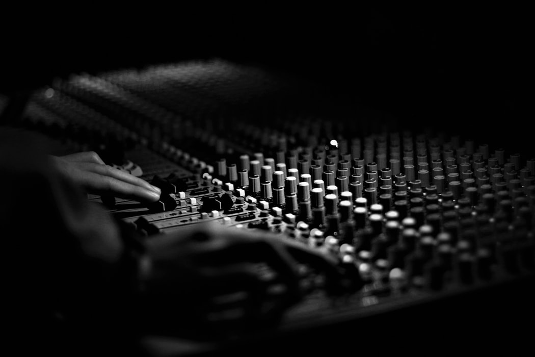 a sound board at a live concert