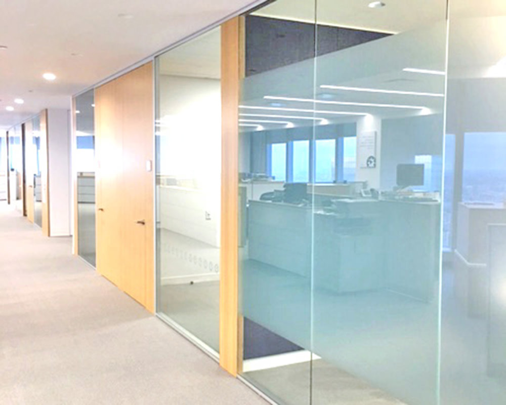 Office Hallway With Frosted Stripe Across Glass Walls