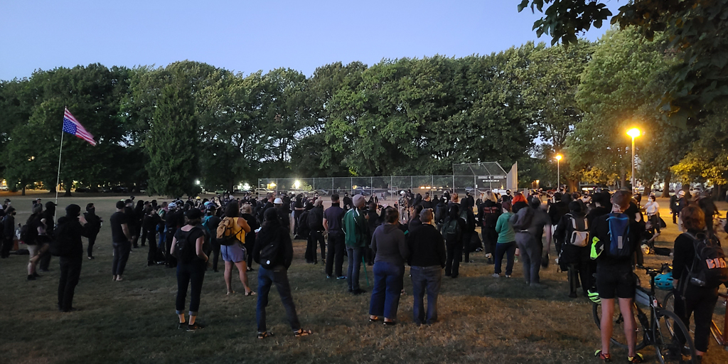 The differences in crowd size between Friday or Saturday nights versus Sunday or weekday nights is truly staggering. More impressive is that the activists DO NOT CARE they are outnumbered tonight and taking on a broken system. Photo by James O'Ryan.