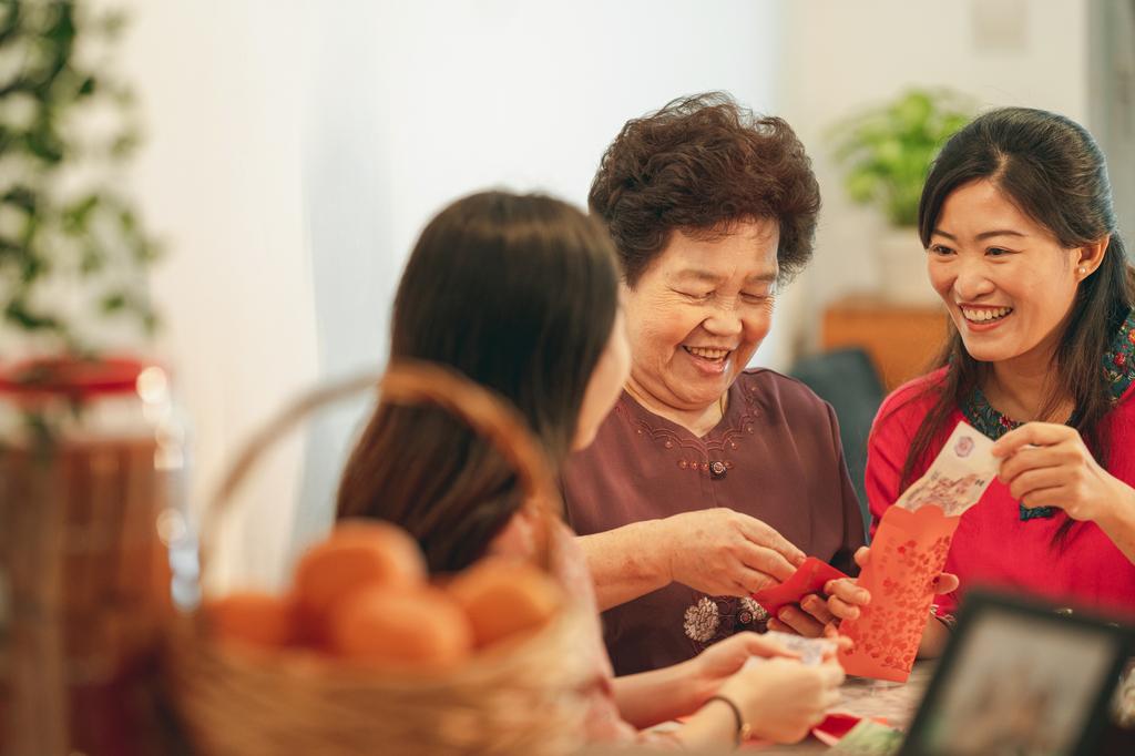 Family members preparing red packets