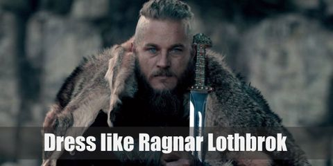 """Ragnar Lothbrok is a Viking Earl and adventurous warrior, so he is often dressed in battle gear that includes many weapons."""