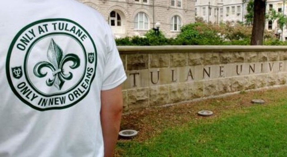 The back of a person with a Tulane shirt and on the right a wall with Tulane University written on it