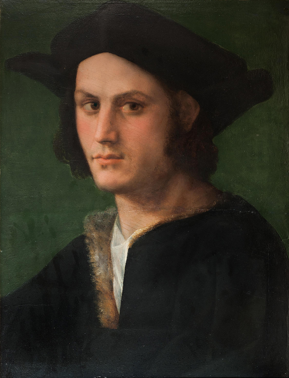 Portrait of a young man wearing hat and looking off to the side.