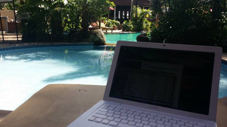 Working by the pool in Thailand