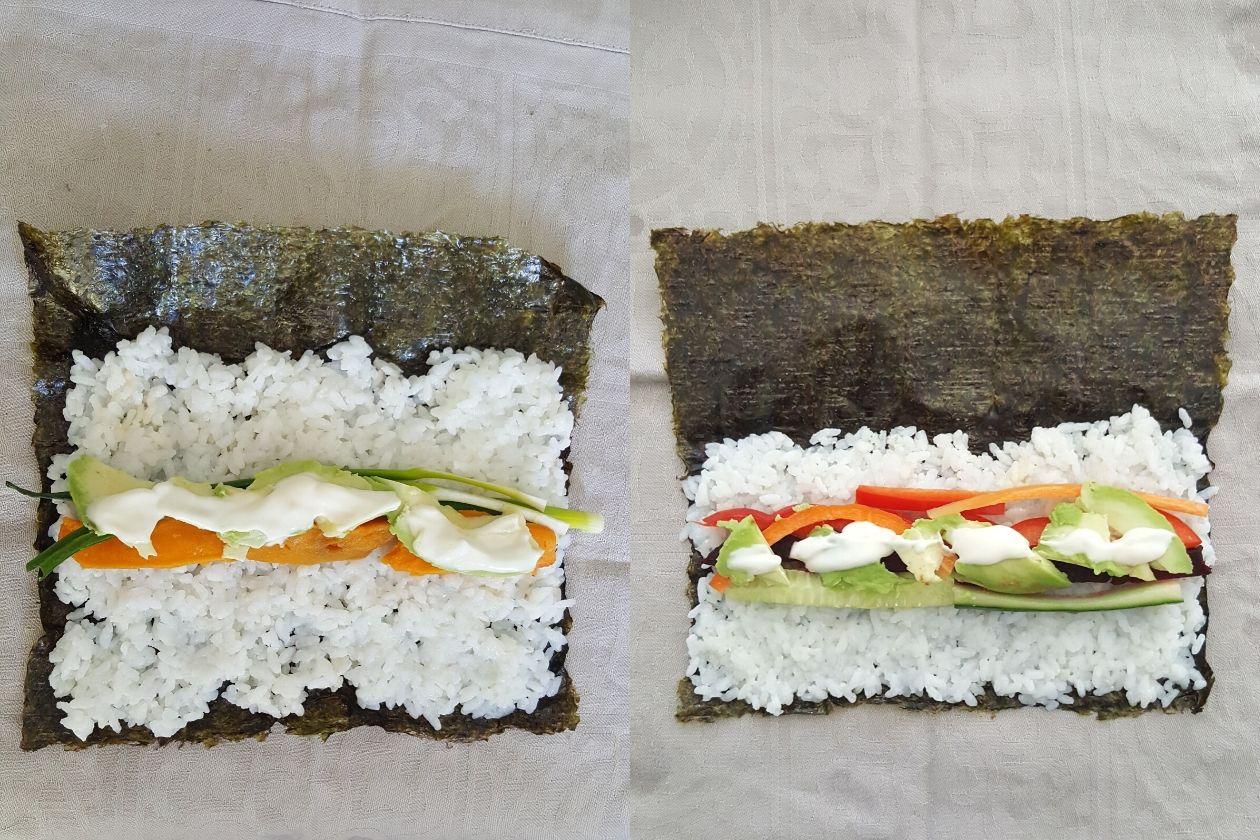 Nori-Blätter mit Reis und Gemüse darauf.