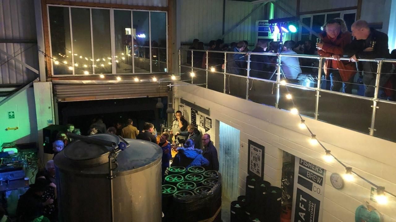 The mezzanine for an event at night