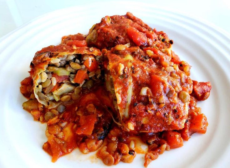 Plate with cabbage rolls stuffed with lentils, and brown rice