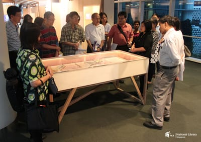 A photo of a tour in progress at the exhibition.