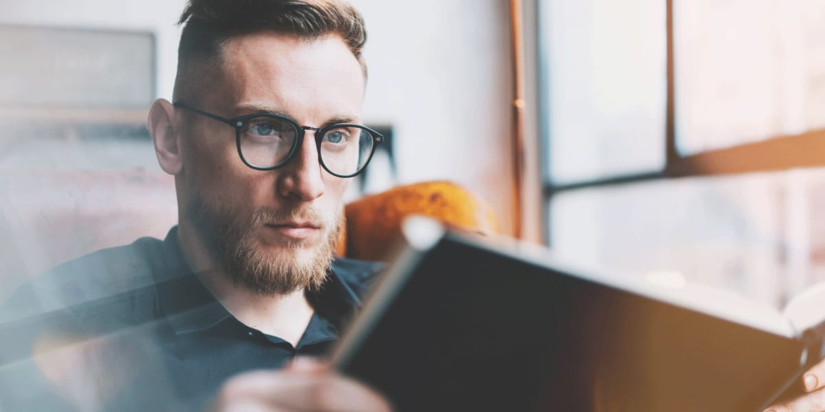 A user experience researcher reading a book