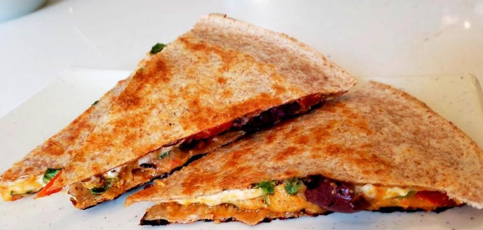 Plate with slices of roasted red pepper quesadilla