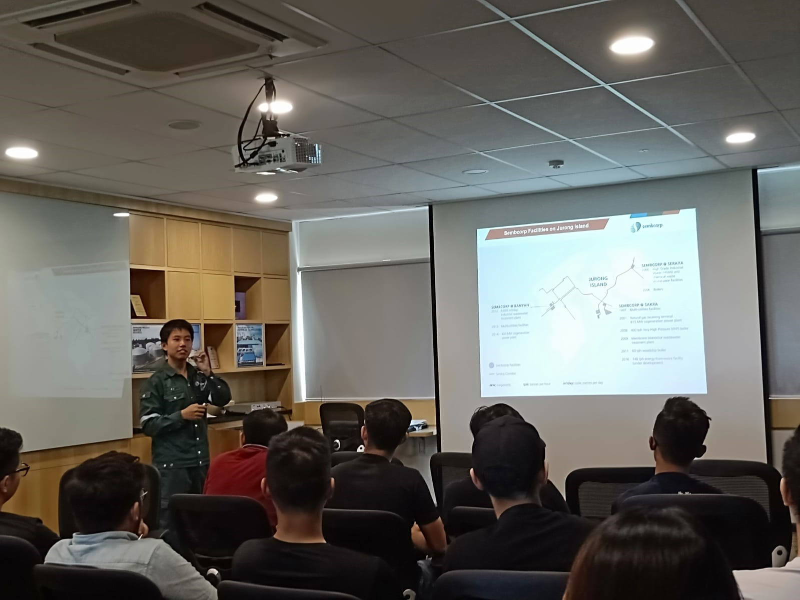 Sembcorp Industries Senior Engineer Ang Kang Jie sharing with students on operations at the Sembcorp Cogen @ Banyan Plant.