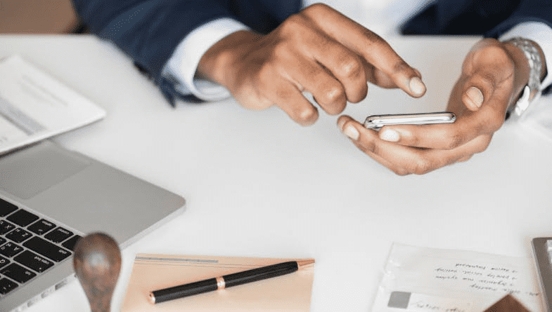 Accountant uses phone sat at desk with laptop, pen, paper, document, books as an accountant not hitting the mark #accountancy