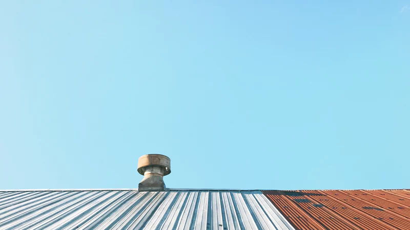 example of while and red metal roofing in california