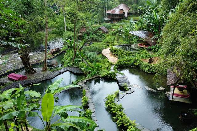 Bambu Indah - A radically distinctive boutique hotel in Ubud, unique luxury experience in a lush natural environment. Dense tropical jungle and river pools.