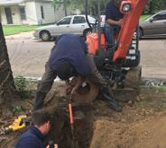 Men digging hole in Wichita