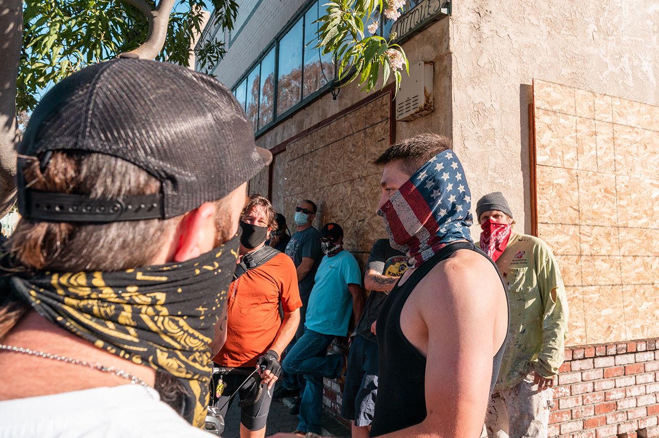 "A counter-protester turns away after engaging in a verbal dispute with a protester during the ""Zero Tolerance for White Supremacy"" protest in Martinez, Calif., on Sunday, July 12, 2020."