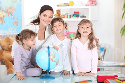 A nanny caring for several children